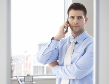 businessman on the phone - portraying the idea that he is speaking to a reporter about nonprofit executive compensation