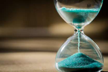 Hourglass with time running out - deadline approaching