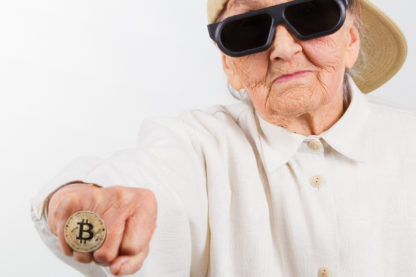 Cool grandma with Bitcoin ring on and sunglasses